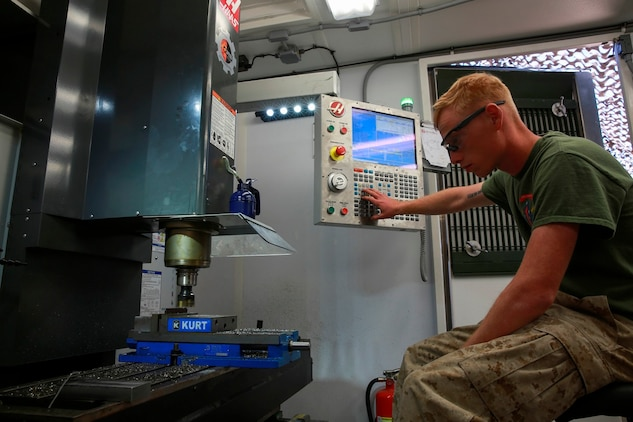 .S. Marine Cpl. Rusty Mongold, a machinist with Engineer Maintenance Company, 1st Maintenance Battalion, 1st Marine Logistics Group cuts a piece of metal using the Computer Numerical Control during exercise Steel Knight at Marine Corps Air Ground Combat Center Twentynine Palms, Calif., Dec. 8, 2016. Steel Knight 2017 is a 1st Marine Division-led exercise that exposes Marines and Sailors to skill sets necessary to operate as a fully capable Marine air ground task force. Mongold is from Port Arthur, Texas. (U.S. Marine Corps photo by PFC Timothy Shoemaker)