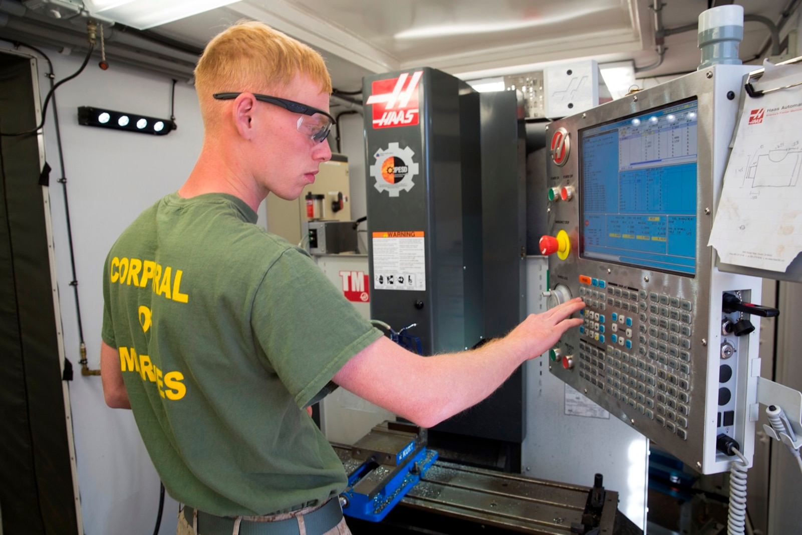 U.S. Marine Cpl. Rusty Mongold, a machinist with Engineer Maintenance Company, 1st Maintenance Battalion, 1st Marine Logistics Group, cuts a piece of metal using the Computer Numerical Control during exercise Steel Knight at Marine Corps Air Ground Combat Center Twentynine Palms, Calif., Dec. 8, 2016. Steel Knight 2017 is a 1st Marine Division-led exercise that exposes Marines and Sailors to skill sets necessary to operate as a fully capable Marine air ground task force. Mongold is from Port Arthur, Texas. (U.S. Marine Corps photo by Sgt. Abbey Perria)