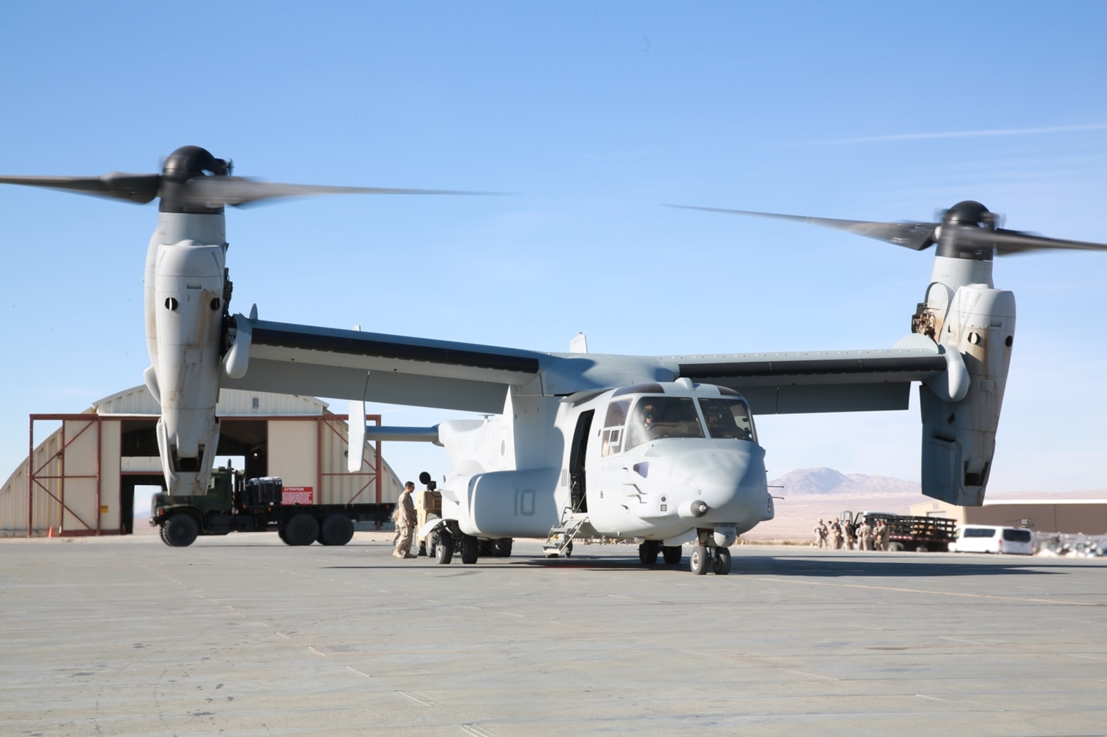 U.S. Marines with Maintenance Management Team, 1st Supply Battalion, 1st Marine Logistics Group, unload a MV-22B Osprey with supplies for Marines participating in exercise Steel Knight at the Strategic Expeditionary Landing Field, Marine Corps Air Ground Combat Center Twentynine Palms, Calif., Dec. 8, 2016. Steel Knight 2017 is a 1st Marine Division-led exercise that exposes Marines and Sailors to skill sets necessary to operate as a fully capable Marine air ground task force. (U.S. Marine Corps photo by PFC Timothy Shoemaker)