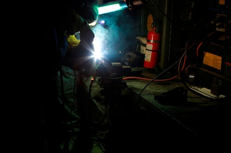 U.S. Marine Cpl. Franky Mitchell, a welder with Heavy Equipment Platoon, 1st Maintenance Battalion, 1st Marine Logistics Group, welds pieces of metal together during exercise Steel Knight at Marine Corps Air Ground Combat Center Twentynine Palms, Calif., Dec. 8, 2016. Steel Knight 2017 is a 1st Marine Division-led exercise that exposes Marines and Sailors to skill sets necessary to operate as a fully capable Marine air ground task force. Mitchell is from Ocata, Fla. (U.S. Marine Corps photo by PFC Timothy Shoemaker)