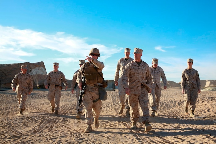 U.S. Marine Col. Jason A. Beaudoin, commanding officer of Marine Corps Logistics Operations Group, tours 1st Maintenance Battalion, 1st Marine Logistics Group's forward operating base during exercise Steel Knight at Marine Corps Air Ground Combat Center Twentynine Palms, Calif., Dec. 8, 2016. Steel Knight 2017 is a 1st Marine Division-led exercise that exposes Marines and Sailors to skill sets necessary to operate as a fully capable Marine air ground task force. (U.S. Marine Corps photo by PFC Timothy Shoemaker)