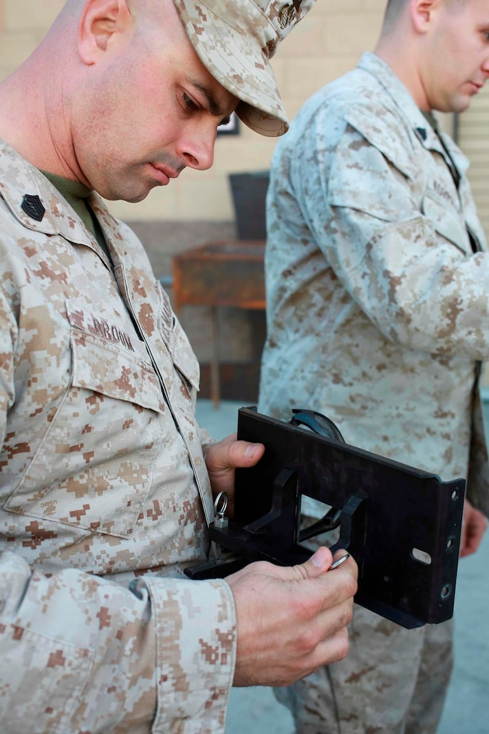 U.S. Marine Gunnery Sgt. Daniel Broom, a machinist with Reparable Maintenance Company, 1st Maintenance Battalion, 1st Marine Logistics Group, inspects a piece that could be printed by a 3-D printer during exercise Steel Knight at Marine Corps Air Ground Combat Center Twentynine Palms, Calif., Dec. 7, 2016. Steel Knight 2017 is a 1st Marine Division-led exercise that exposes Marines and Sailors to skill sets necessary to operate as a fully capable Marine air ground task force. Broom is from Atlanta, Ga. (U.S. Marine Corps photo by PFC Timothy Shoemaker)