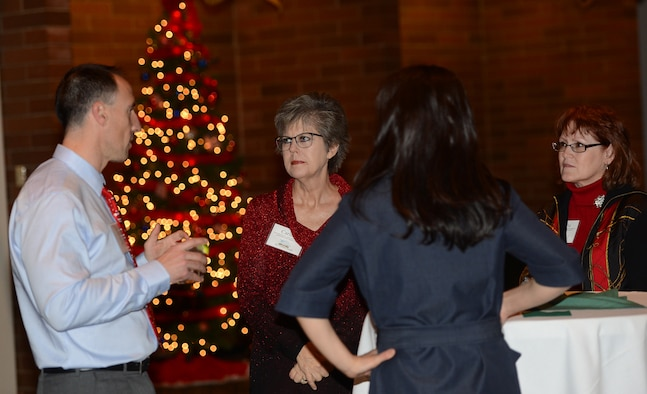 Col. Leonard Kosinski (left), 62nd Airlift Wing commander, talks to Team McChord civic leaders at the Team McChord annual civic leader holiday party Dec. 10, 2016, at the McChord Club on Joint Base Lewis-McChord, Wash. The annual event is held yearly to thank civic leaders for their support throughout the year. (U.S. Air Force photo/Senior Airman Jacob Jimenez)