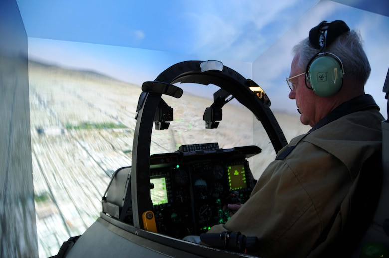 Retired Major General James W. Graves, flies the A-10C Thunderbolt II simulator during the 47th Fighter Squadron alumni visit at Davis-Monthan Air Force Base, Ariz., Dec. 6, 2016. To better understand the unit's current aircraft, the alums were given the opportunity to sit in the simulator and compete in teams of two. Graves is a former Assistant to the Chairman Joint Chief of Staff for Reserve matters and former 47 FS commander 1996-1997. (U.S. Air Force photo by Tech. Sgt. Courtney Richardson)