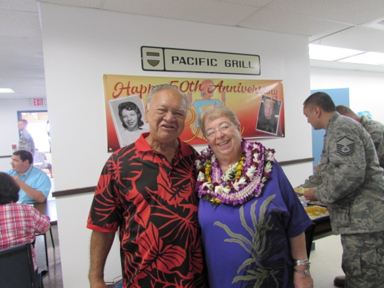 """Charlene """"Aunty Char"""" Kaawaloa and her husband Larry smile in front of a poster commemorating Charlene's 50 years of service at Kaena Point Satellite Tracking Station, Hawaii, Wednesday, Dec. 7, 2016. Kaawaloa started working as a contractor at Kaena Point in 1966, when the station was relatively new.(Courtesy photo)"""