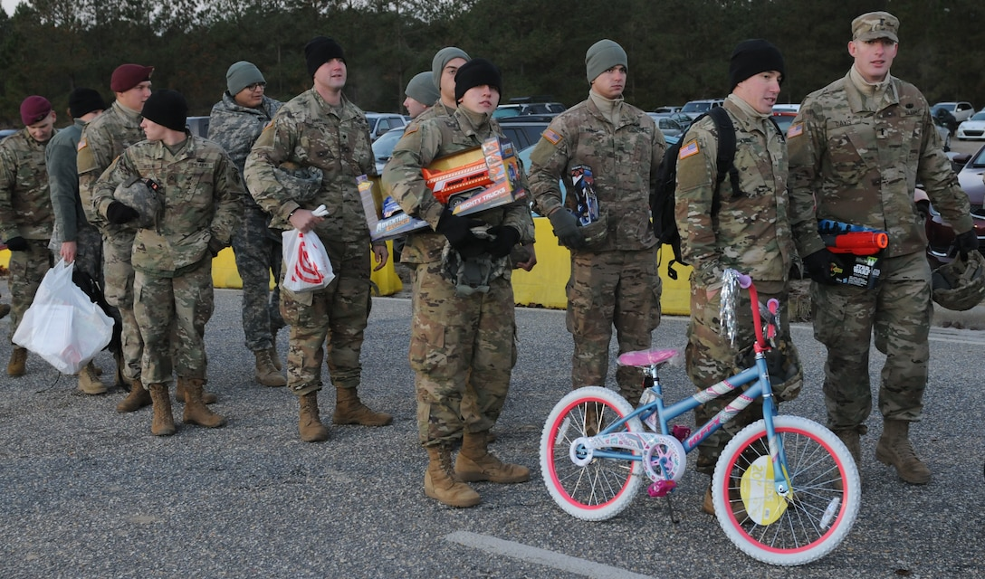 Soldiers wait in long lines braving sub freezing temperatures for a chance to be one of the selected individuals to jump. Operation Toy Drop is a U.S. Army Civil Affairs & Psychological Operations Command (Airborne), U.S. Army Reserve's annual collective training exercise used to prepare Soldiers to support Global Combatant Commanders and Army Service Component Commanders in theater of operations around the world. (U.S. Army Reserve photo by Staff Sgt. William K. Gillespie)