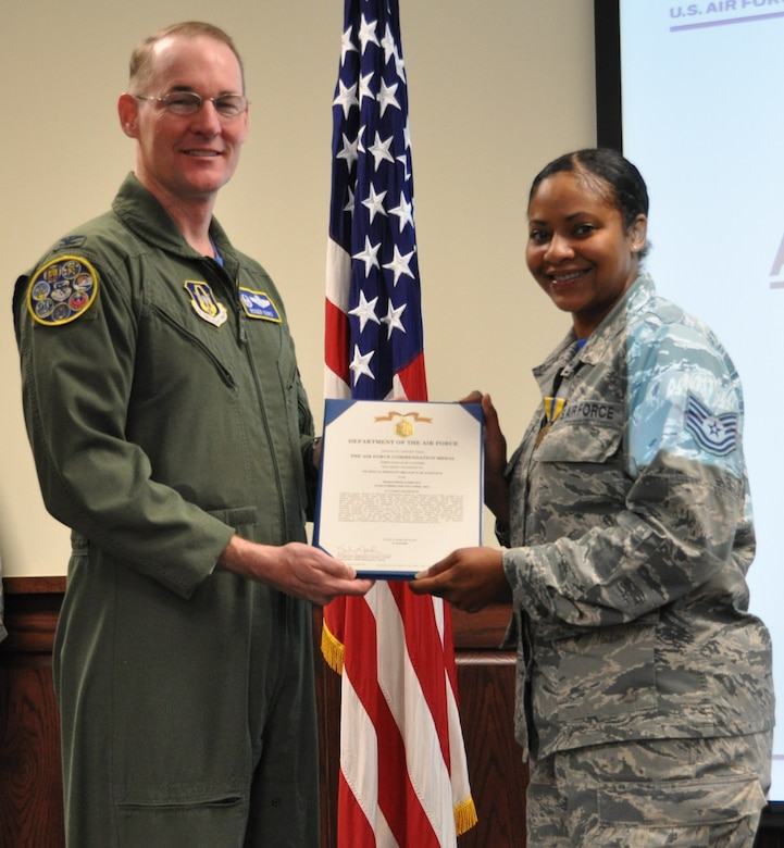 Tech. Sgt. Brianne Blackstock receives an Air Force Commendation Medal from 340th FTG commander, Col. Roger Suro  at the Group's MUTA held Dec. 1-2 at Joint Base San Antonio-Randolph, Texas (Photo by Janis El Shabazz).