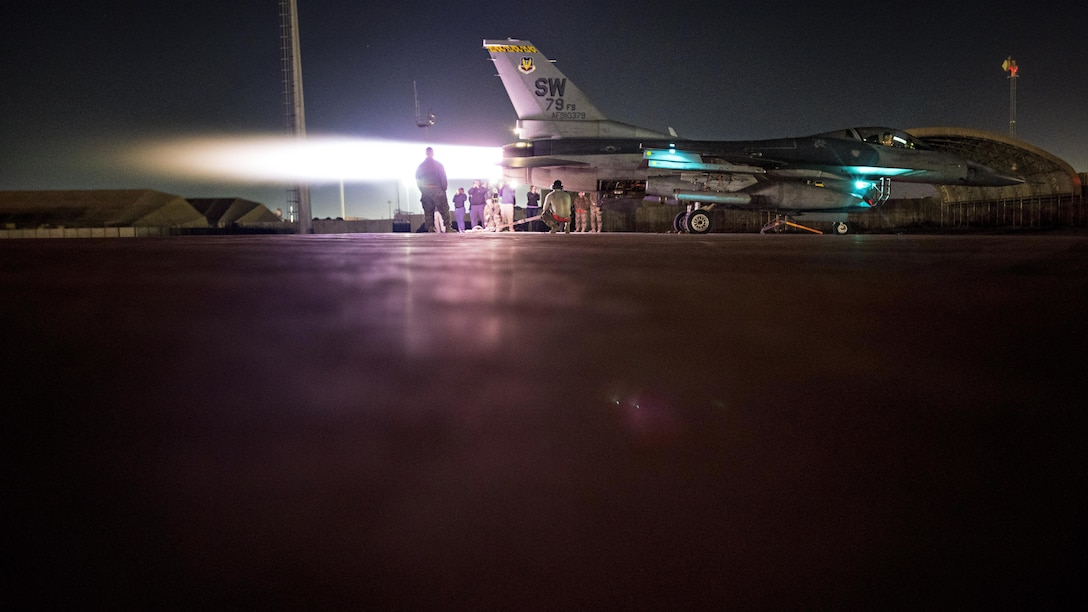 Staff Sgt. Erin Diaz and Senior Airmen Dakota Tabler and Logan Helle, 455th Expeditionary Maintenance Squadron engine technicians, conduct an augmentor operations check on an F-16 Fighting Falcon Dec. 4, 2016 at Bagram Airfield, Afghanistan. The operations check was conducted after installing a new engine component. (U.S. Air Force photo by Staff Sgt. Katherine Spessa)