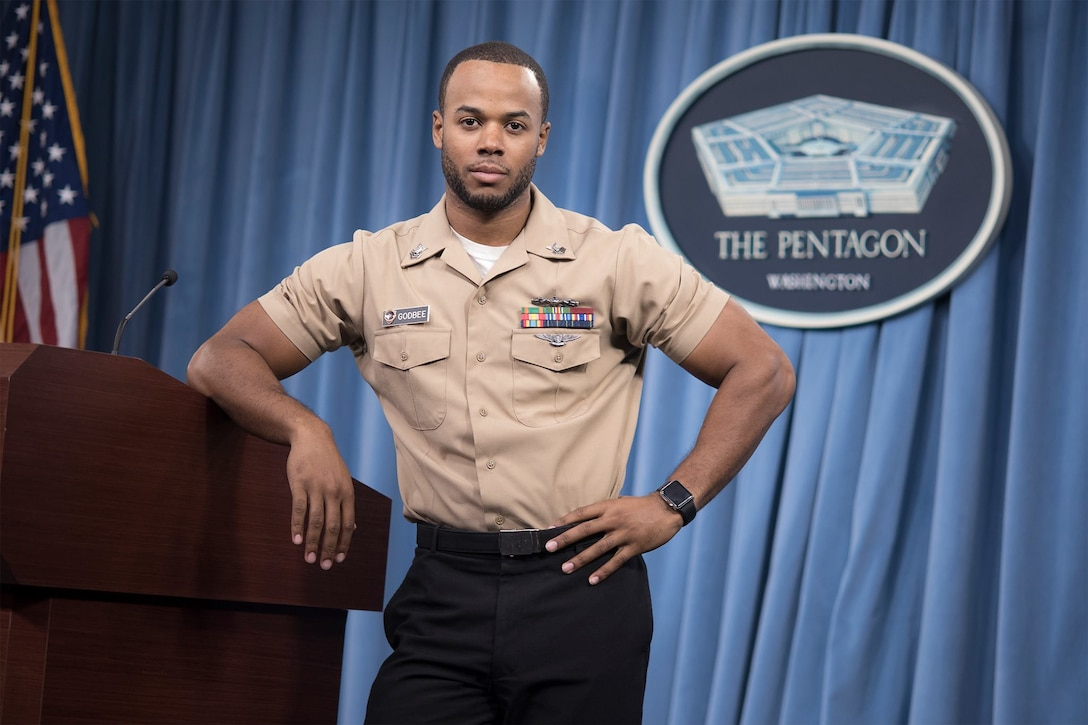 Navy Petty Officer 1st Class Timothy Godbee poses for a photo at the Pentagon, Washington, D.C., Dec. 7, 2016.  He is the personal photojournalist to Secretary of Defense Ashton B. Carter. (Photo by Daniel Hinton)