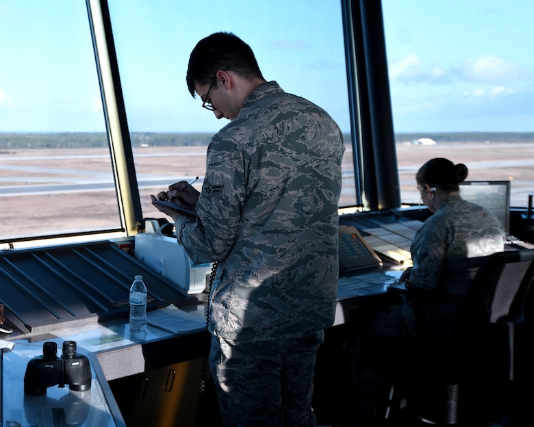 U.S. Air Force Airmen 1st Class Nicolas Flores Tessa Alzuri, air traffic control journeymen from the 325th Operations Support Squadron, annotate aircraft movement during Checkered Flag 17-1 and Combat Archer 17-3, Tyndall Air Force Base, Fla., Dec. 12, 2016. Air traffic controllers are responsible for an additional 40 aircraft from around the country that are at Tyndall in support of the concurrent exercises Dec. 5-16. (U.S. Air Force photo by Airman 1st Class Isaiah J. Soliz/Released)