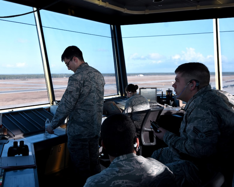 U.S. Air Force air traffic controllers from the 325th Operations Support Squadron monitor and direct air traffic during exercises Checkered Flag 17-1 and Combat Archer 17-3 at Tyndall Air Force Base, Fla., Dec. 12, 2016. The 325th OSS air traffic controllers have the responsibility of safely and efficiently managing the increased flow of aircraft into and out of Tyndall AFB. (U.S. Air Force photo by Airman 1st Class Isaiah J. Soliz/Released)