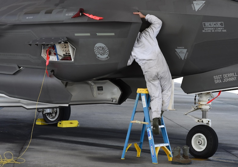 A U.S. Air Force F-35A Lightning II aircraft maintainer from Eglin Air Force Base inspects the intake of a jet during Checkered Flag 17-1 at Tyndall Air Force Base, Fla., Dec. 8, 2016. More than 90 Eglin personnel came to Tyndall in support of the large-scale, total force exercise. (U.S. Air Force photo by Staff Sgt. Alex Fox Echols III/Released)