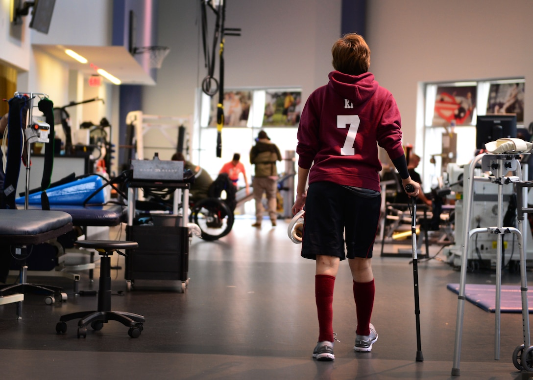 Kianni Martinez walks to her next exercise during her rehabilitation session at the Center for the Intrepid at Joint Base San Antonio-Fort Sam Houston, Texas, Dec. 7, 2016. During the Brussels Airport bombing March 22, 2016, that tragically killed her mother and injured her family members, Kianni suffered multiple burns and injuries to her leg and has since undergone a number of grueling rehabilitative procedures. (U.S. Air Force photo by Senior Airman Chip Pons)
