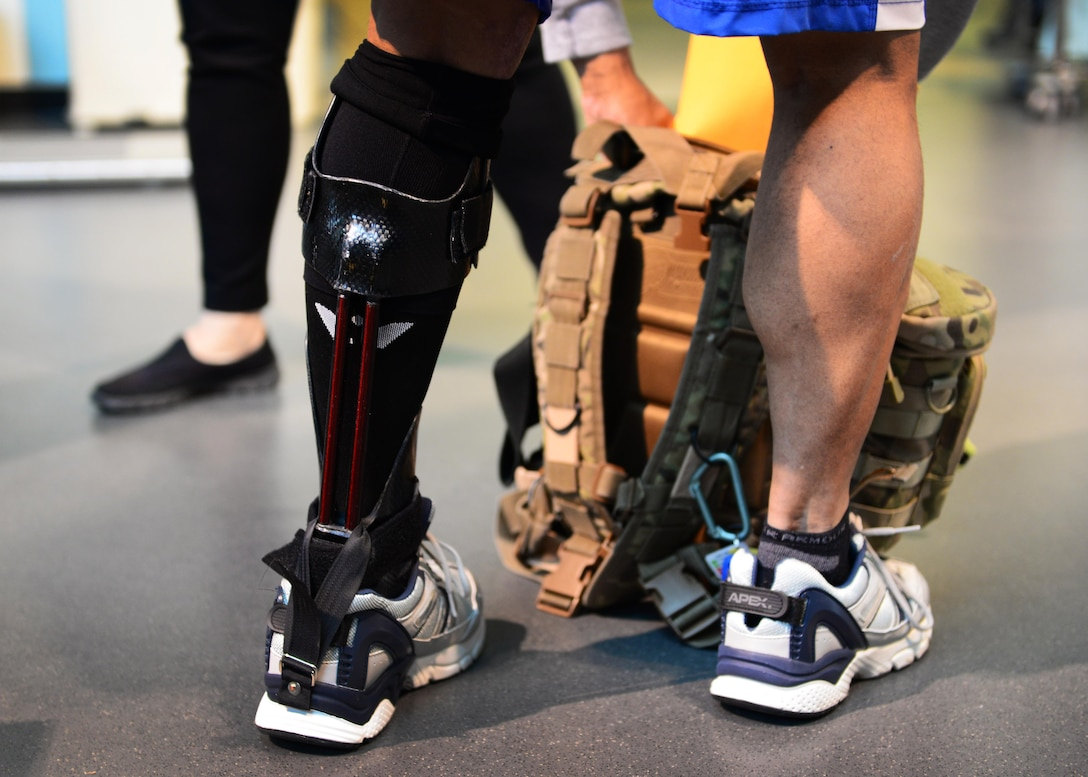 """U.S. Air Force Lt. Col. Melchizedek """"Kato"""" Martinez, a career tactical communications officer, prepares for a rehabilitation session at the Center for the Intrepid at Joint Base San Antonio-Fort Sam Houston, Texas, Dec. 7, 2016. During the Brussels Airport bombing March 22, 2016, which tragically killed his wife and injured his children, Kato suffered multiple burns and injuries and has since undergone a number of grueling rehabilitative procedures. (U.S. Air Force photo by Senior Airman Chip Pons)"""