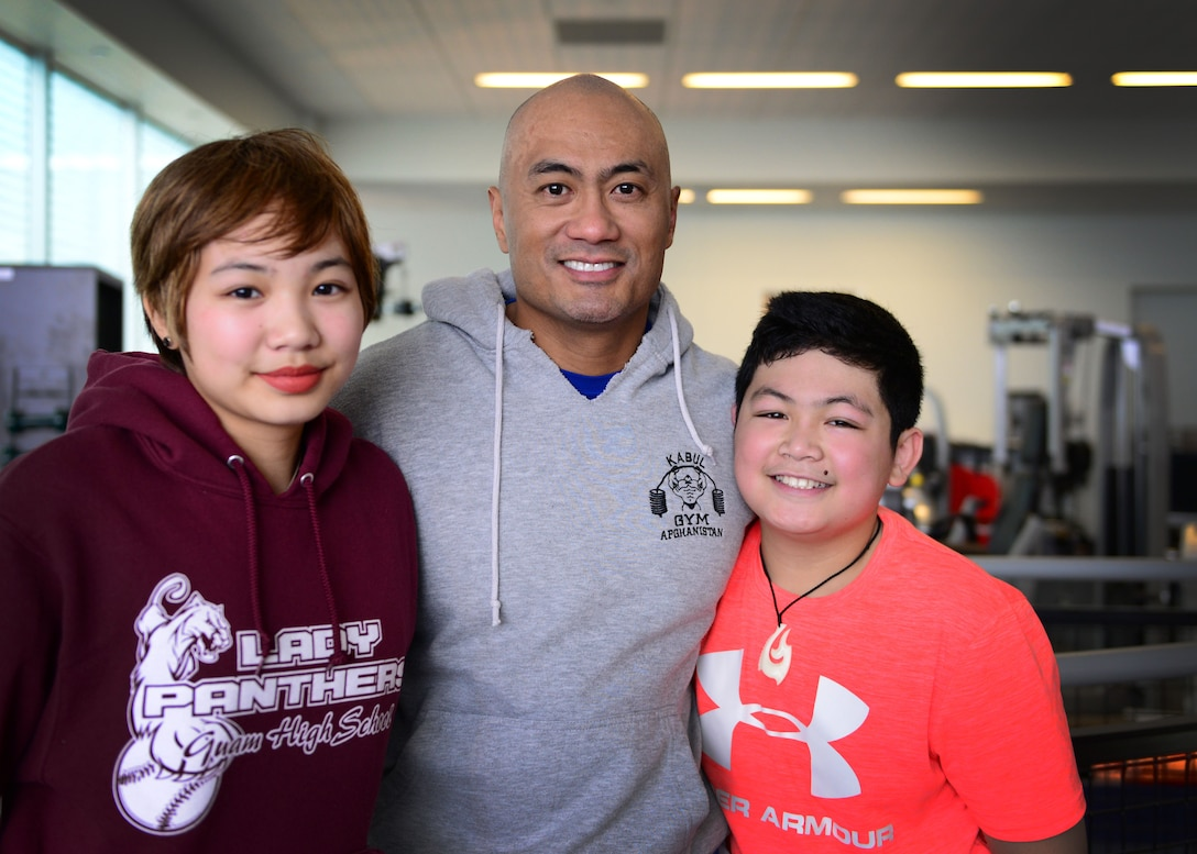 "U.S. Air Force Lt. Col. Melchizedek ""Kato"" Martinez (center) and two of his children, Kianni (left) and Kimo (right) pose for a photo after an extensive rehabilitation session at the Center for the Intrepid at Joint Base San Antonio- Fort Sam Houston, Texas, Dec. 7, 2016. During the Brussels Airport bombing March 22, 2016, that tragically killed his wife and injured him and his children, Kato and his children have faced a long road to recovery with determination and resiliency. (U.S. Air Force photo by Senior Airman Chip Pons)"