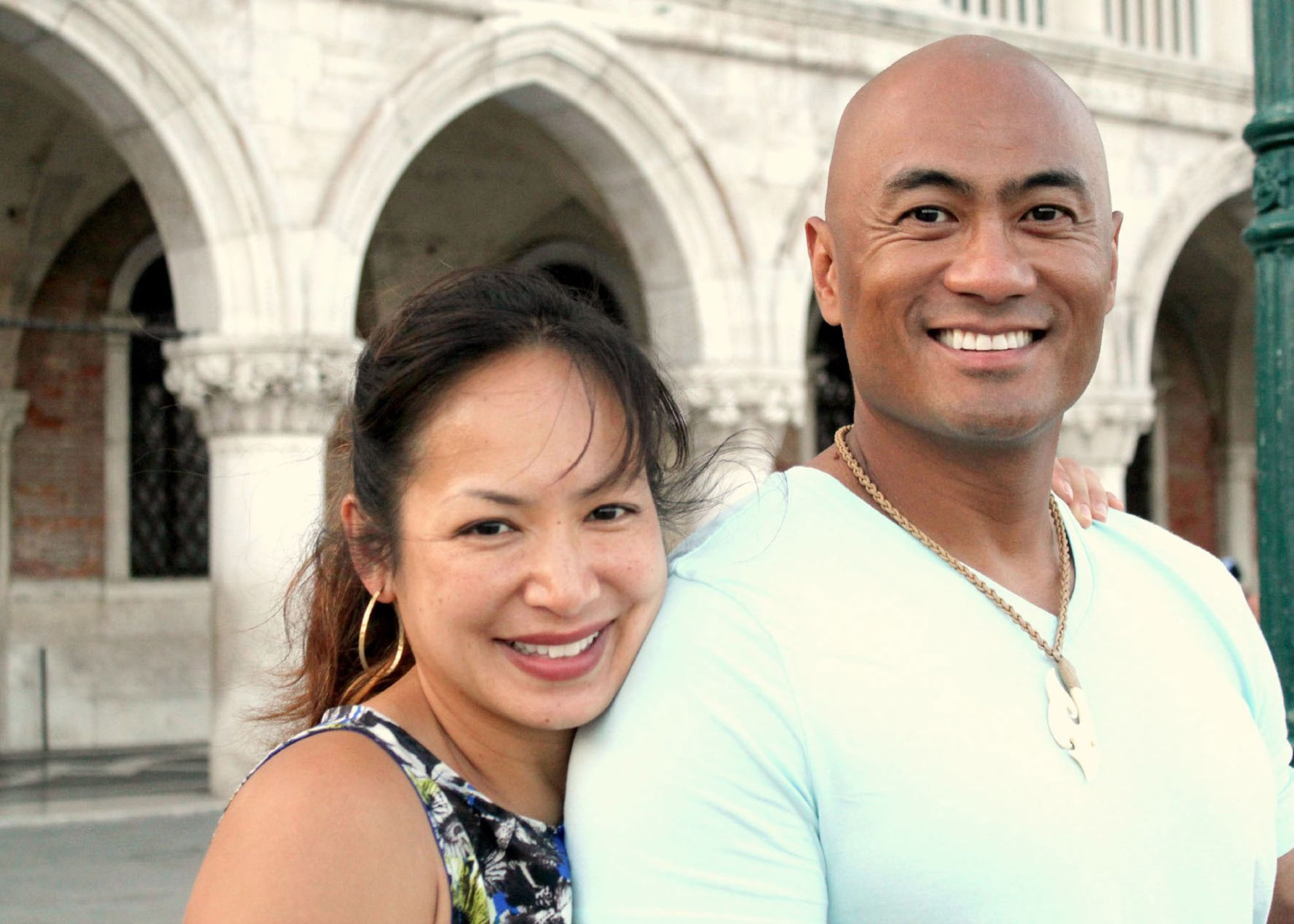 """U.S. Air Force Lt. Col. Lt. Col. Melchizedek """"Kato"""" Martinez poses with his wife, Gail, during a family vacation to Venice, Italy. The Martinez family's life was forever changed March 22, 2016, when Gail was tragically killed during the Brussels Airport bombing. (Courtesy photo)"""