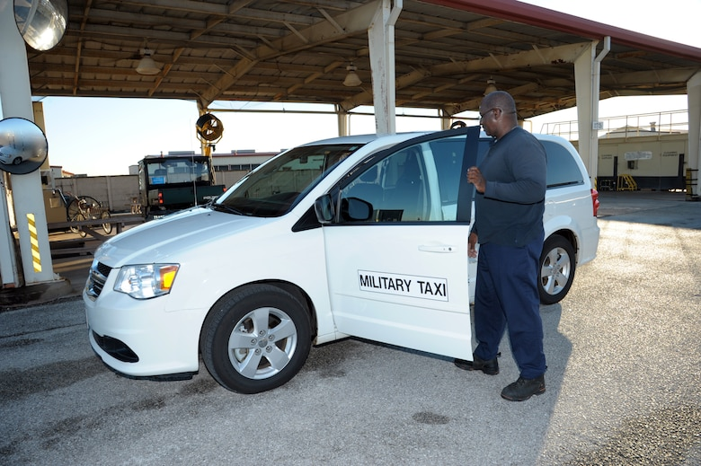 Donald Cruz, 502nd Logistics Readiness Squadron vehicle operator, inspects his taxi Dec. 6 at Joint Base San Antonio-Randolph. When members at Joint Base San Antonio locations need a ride for work-related functions, they call on the 502nd Logistics Readiness Squadron military taxi to help them get to their destination.