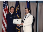 Timothy Pinkham Receives the DIA Directors Award from Major General Richard Carr, 1991
