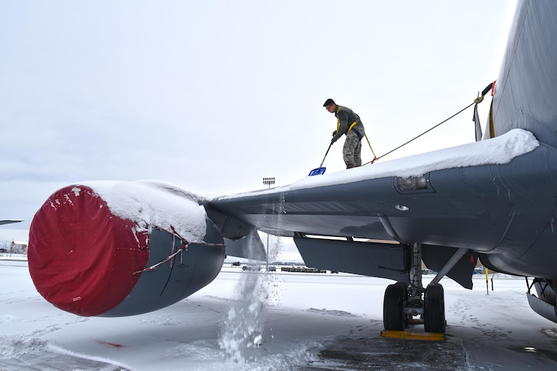 Airman Jesus Hilario, 92nd Aircraft Maintenance Squadron crew chief, manually deices a KC-135 Stratotanker by shoveling snow off of the wing Dec. 12, 2016, at Fairchild Air Force Base, Washington. During the winter months, Airmen remove the snow sitting on and around the aircraft using shovels and ropes. (U.S. Air Force photo/Senior Airman Mackenzie Richardson)