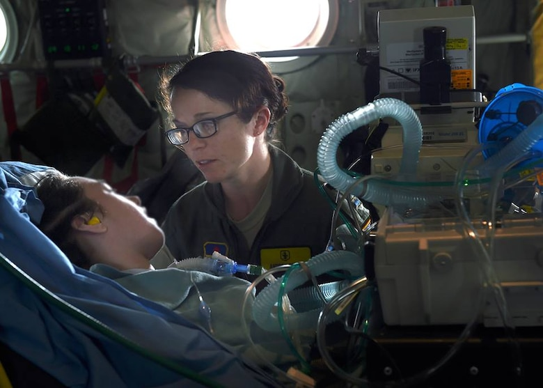 2nd Lt. Andrea Perez, member of the 59th Medical Wing Acute Lung Rescue Transport team, monitor a patient onboard a C-130J Super Hercules, Dec. 12, 2016. The 59th Medical Wing's Acute Lung Rescue Team provided medical care for a military dependent, during the four-hour flight.. (U.S. Air Force photo/Staff Sgt. Jason Huddleston)