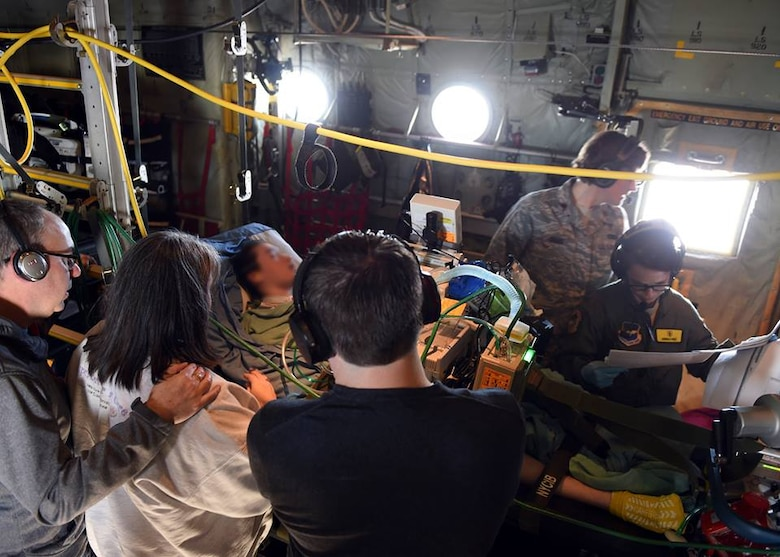 Members of the 59th Medical Wing Acute Lung Rescue Transport team monitor a patient onboard a C-130J Super Hercules, Dec. 12, 2016. A unique 59th Medical Wing capability, the ECMO transport program began at Wilford Hall Medical Center in the 1990s. (U.S. Air Force photo/Staff Sgt. Jason Huddleston)