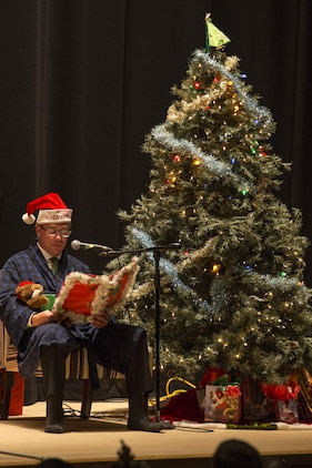 "Jeffrey Carr, Matthew C. Perry High School assistant principal, narrates as the symphonic band plays ""The Night Before Christmas"" during the annual holiday celebration concert at the Sakura Assembly Hall at Marine Corps Air Station Iwakuni, Japan, Dec. 7, 2016. The concert showcased various musical groups from M.C. Perry and brought base residents, students and staff from Suo-Oshima Municipal Elementary School, Waki Junior High School and Otake Municipal Ogata Junior High School together. To start the concert, the symphonic band played ""Angels We Have Heard on High"" to approximately 300 guests inside the theater. (U.S. Marine Corps photo by Cpl. Aaron Henson)"