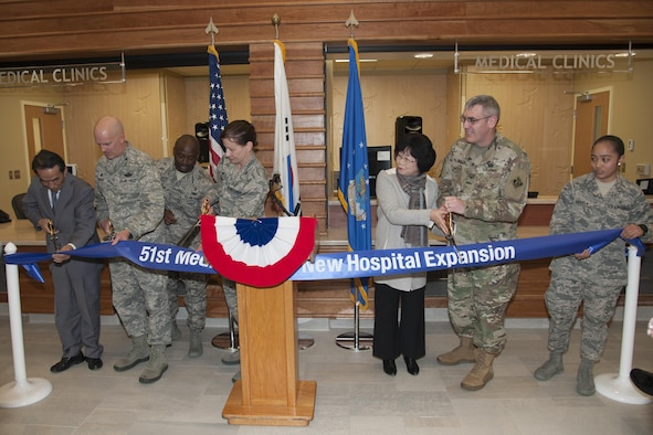 Representatives from Seohee Construction Company, the 51st Fighter Wing and Army Corps of Engineers Far East District cut a ribbon during the 51st Medical Group Phase One Hospital Expansion ribbon-cutting ceremony on Osan Air Base, Republic of Korea, Dec. 12, 2016. Phase one of the expansion included new clinics for family health, women's health, pediatrics, and education and training . (U.S. Air Force photo by Staff Sgt. Jonathan Steffen)