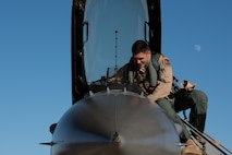 An F-16 Fighting Falcon pilot with the 134th Expeditionary Fighter Squadron removes exits his aircraft after arriving at the 407th Air Expeditionary Group, Southwest Asia, Dec. 10, 2016. The F-16 squadron is comprised of Airmen from the 158th Fighter Wing of the Vermont Air National Guard. (U.S. Air Force photo by Master Sgt. Benjamin Wilson)(Released)