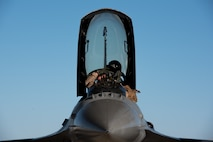 An F-16 Fighting Falcon pilot with the 134th Expeditionary Fighter Squadron removes his helmet after arriving at the 407th Air Expeditionary Group, Southwest Asia, Dec. 10, 2016. The F-16 squadron is comprised of Airmen from the 158th Fighter Wing of the Vermont Air National Guard. (U.S. Air Force photo by Master Sgt. Benjamin Wilson)(Released)