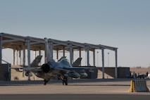 An F-16 Fighting Falcon assigned to the 134th Expeditionary Fighter Squadron taxis onto the ramp at the 407th Air Expeditionary Group, Southwest Asia, Dec. 10, 2016. The F-16 squadron is comprised of Airmen from the 158th Fighter Wing of the Vermont Air National Guard. (U.S. Air Force photo by Master Sgt. Benjamin Wilson)(Released)
