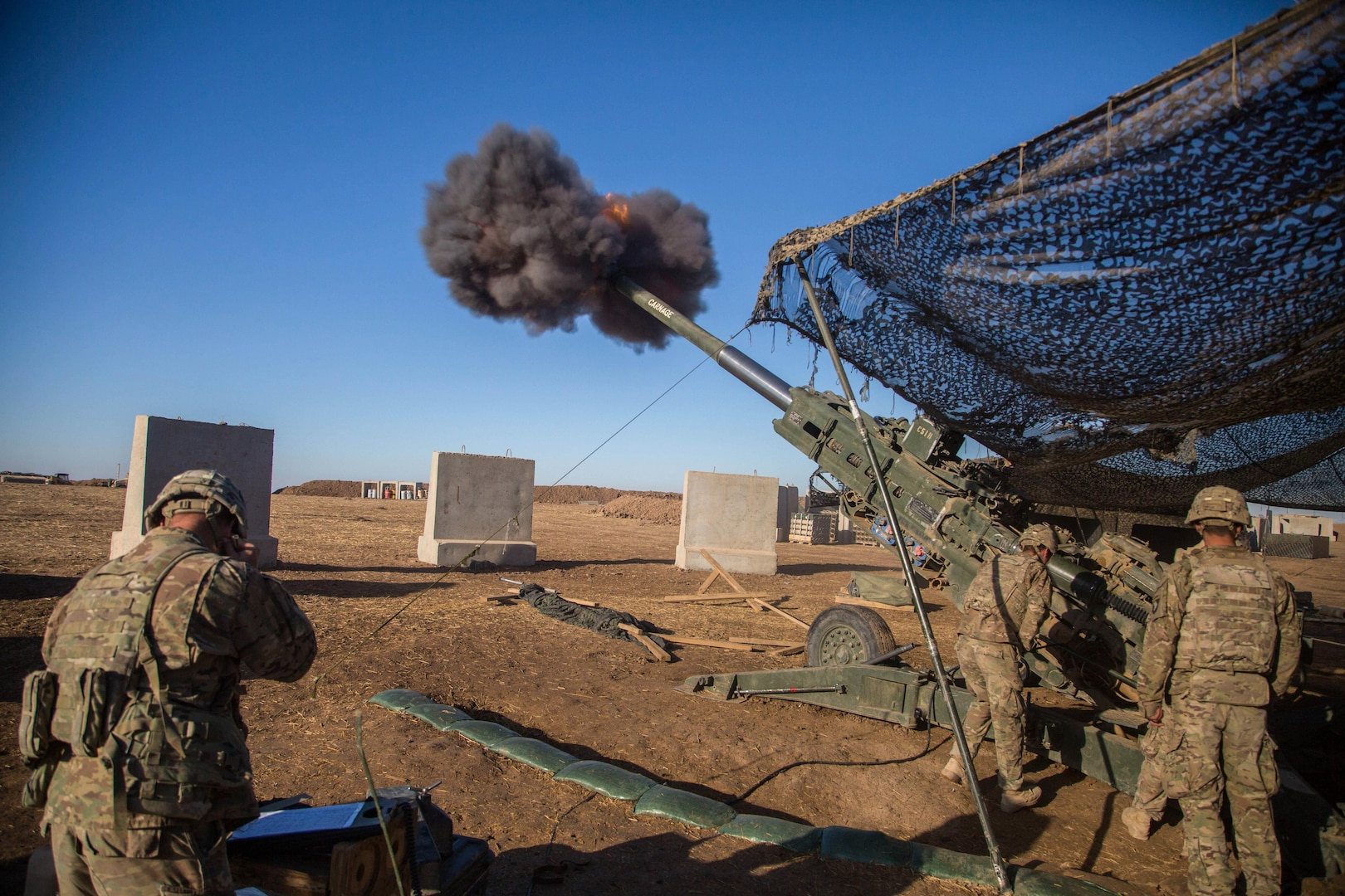 U.S. Soldiers assigned to Charlie Battery, 1st Battalion, 320th Field Artillery Regiment, 2nd Brigade Combat Team, 101st Airborne Division fire a M777 A2 Howitzer in support of Iraqi security forces at Platoon Assembly Area 14, Iraq, Dec. 7, 2016. Charlie Battery conducted the fire mission in support of Combined Joint Task Force - Operation Inherent Resolve, the global Coalition to defeat ISIL in Iraq and Syria.  (U.S. Army photo by Spc. Christopher Brecht)