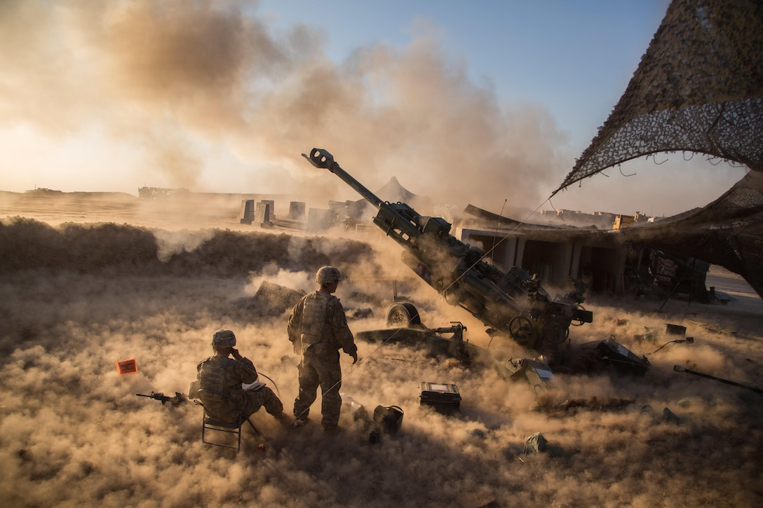 U.S. Soldiers assigned to Charlie Battery, 1st Battalion, 320th Field Artillery Regiment, 2nd Brigade Combat Team, 101st Airborne Division fire a M777 A2 Howitzer in support of Operation Inherent Resolve at Platoon Assembly Area 14, Iraq, Nov. 29, 2016. The United States stands with a global Coalition of more than 60 international partners to assist and support the Iraqi security forces to degrade and defeat ISIL.  Combined Joint Task Force-Operation Inherent Resolve is the global Coalition to defeat ISIL in Iraq and Syria.  (U.S. Army photo by Spc. Christopher Brecht)
