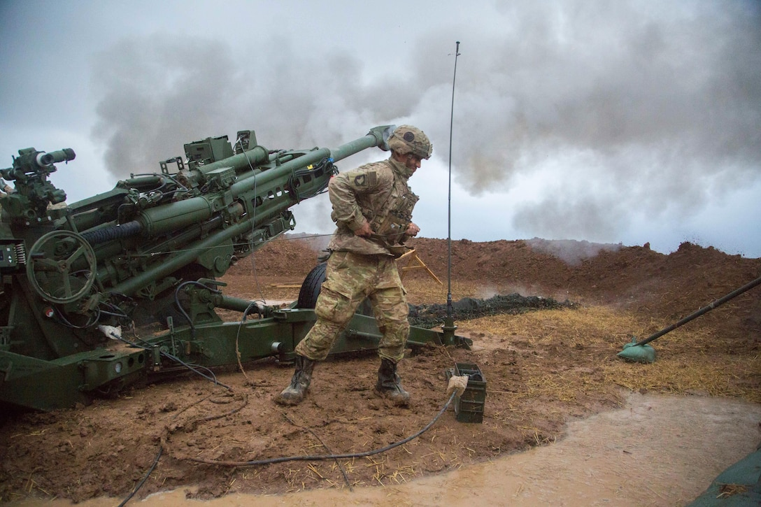 U.S. Army Spc. Eduardo Valencio, Charlie Battery, 1st Battalion, 320th Field Artillery Regiment, 2nd Brigade Combat Team, 101st Airborne Division, fires a M777 A2 Howitzer in support of Operation Inherent Resolve at Platoon Assembly Area 14, Iraq, Dec. 2, 2016. Charlie Battery conducted the fire mission in support of Combined Joint Task Force - Operation Inherent Resolve, the global Coalition to defeat ISIL in Iraq and Syria.  (U.S. Army photo by Spc. Christopher Brecht)
