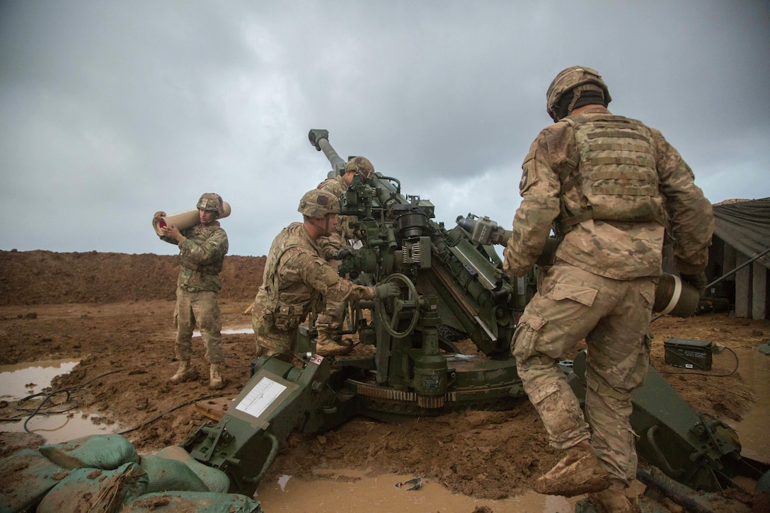 U.S. Soldiers assigned to Charlie Battery, 1st Battalion, 320th Field Artillery Regiment, 2nd Brigade Combat Team, 101st Airborne Division prepare for a fire mission in support of Iraqi and Kurdish forces during Operation Inherent Resolve at Platoon Assembly Area 14, Iraq, Dec. 2, 2016. Charlie Battery conducted the fire mission in support of Combined Joint Task Force - Operation Inherent Resolve, the global Coalition to defeat ISIL in Iraq and Syria.  (U.S. Army photo by Spc. Christopher Brecht)