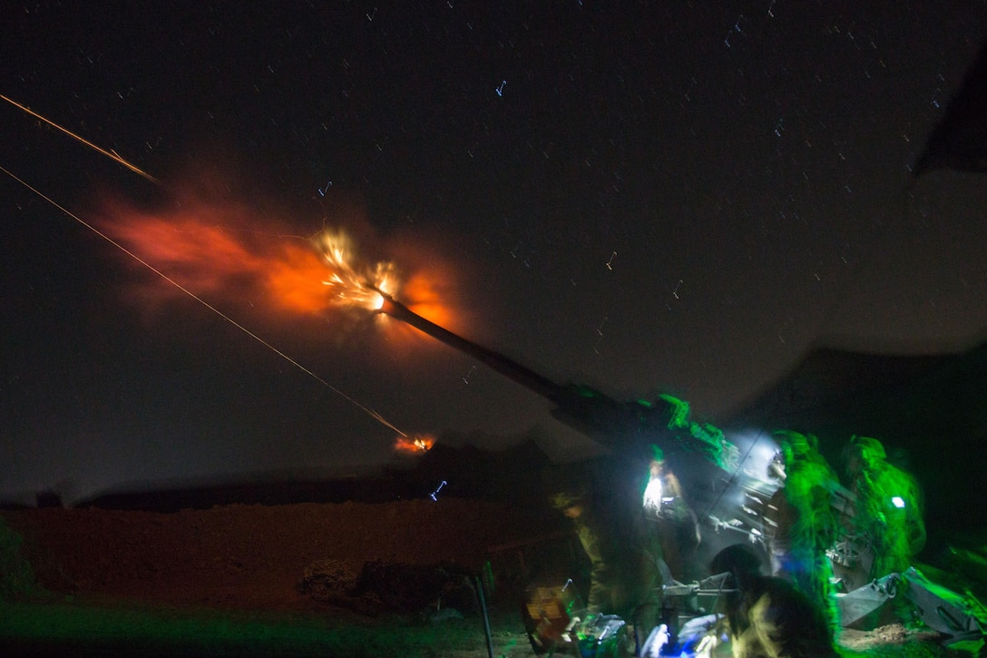 U.S. Soldiers assigned to Charlie Battery, 1st Battalion, 320th Field Artillery Regiment, 2nd Brigade Combat Team, 101st Airborne Division fire a M777 A2 Howitzer at night in support of Iraqi security forces at Platoon Assembly Area 14, Iraq, Dec. 7, 2016. Charlie Battery conducted the fire mission in support of Combined Joint Task Force - Operation Inherent Resolve, the global Coalition to defeat ISIL in Iraq and Syria.  (U.S. Army photo by Spc. Christopher Brecht)