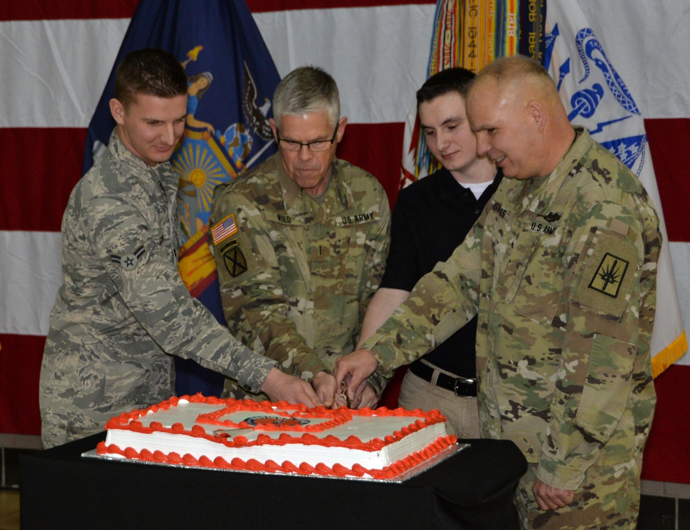 Brig. Gen. Raymond Shields, assistant adjutant general, Army, far right, joins the oldest and newest members of the New York National Guard to cut a cake in celebration of the National Guard's 380th birthday at New York National Guard headquarters on Dec. 13, 2016. The new and old members are, from left, Airman Kevin Gabay, of the New York Air National Guard's 109th Airlift Wing;Chief Warrant Officer 5 Robert Wold, one of the New York Army National Guard's oldest serving Soldier; and  Pvt. Private Cameron Thompson, New York Army National Guard.