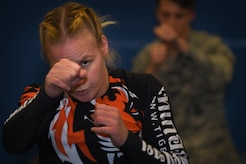 Valentina Shevchenko, UFC Bantamweight fighter, warms up with U.S. Air Force Airmen before training at Joint Base Langley-Eustis, Va., Dec. 8, 2016. Airmen and Soldiers from the installation volunteered to train with Shevchenko during the UFC morale visit to help her prepare for an upcoming fight. (U.S. Air Force photo by Staff Sgt. Natasha Stannard)