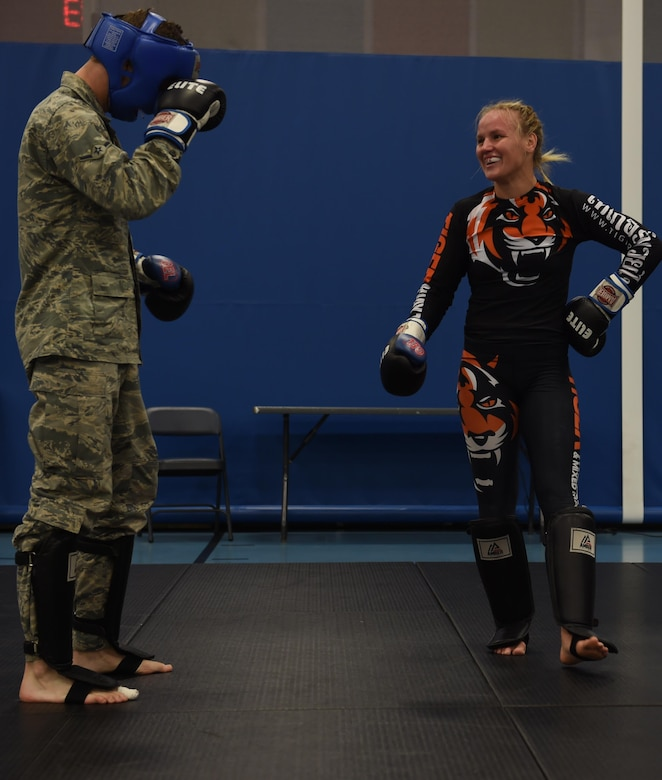 U.S. Air Force Airmen work out with Valentina Shevchenko, UFC Bantamweight fighter, at Joint Base Langley-Eustis, Va., Dec. 8, 2016. Schevchenko toured the installation along with fellow fighters Ben Rothwell and Lorenz Larkin and MAA radio hosts. (U.S. Air Force photo by Staff Sgt. Natasha Stannard)