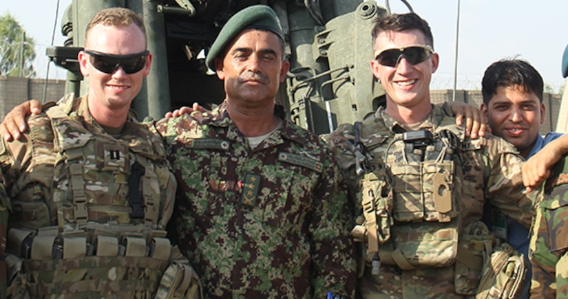 Capt. Dennis M. Kelly, a fire support advisor with Train, Advise, Assist Command – East takes a moment to pose with Col. Ahmed Jan, fire support officer, 201st Corps. The two have a special bond that's helped lead to especially-effective artillery and air support in Afghanistan's eastern provinces. (U.S. Army Photo by Capt. Grace Geiger)