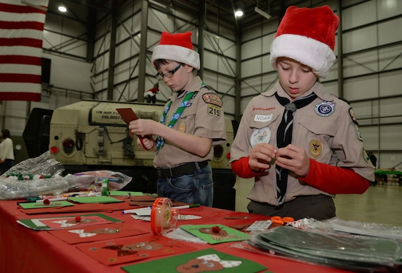 Children from Cub Scout pack 215 create holiday cards during the annual Children's Holiday Party Dec. 10, 2016, on RAF Mildenhall, England. The Hearts Apart event and holiday party provided Team Mildenhall families an opportunity to come together in celebration of the holiday season through games, food and crafts. They had more than 800 people in attendance – largest number of attendees in event's history. (U.S. Air Force photo by Senior Airman Christine Halan)