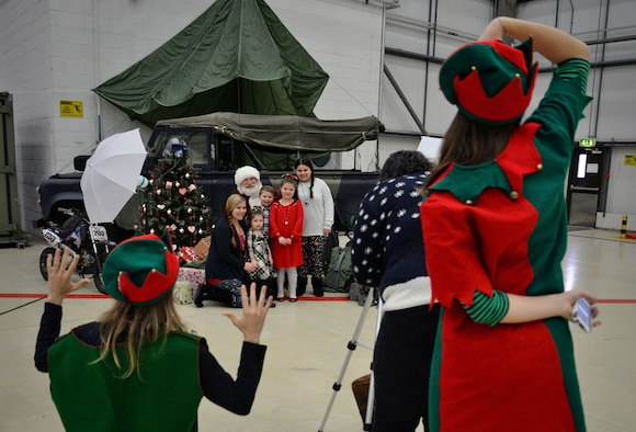 Team Mildenhall families take photographs with Santa during the annual Children's Holiday Party Dec. 10, 2016, on RAF Mildenhall, England. This year's Hearts Apart and Children's Holiday party was hosted by the Military Spouses Club. (U.S. Air Force photo by Senior Airman Christine Halan)