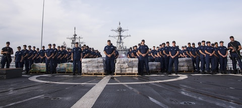 Coast Guard Cutter Waesche crewmembers offload seized cocaine from the cutter in San Diego on Oct. 27, 2016. Nearly 20 tons of narcotics were interdicted in international waters off the coast of Central and South America. Operation Martillo is a joint, interagency and multinational collaborative effort to deny transnational criminal organizations air and maritime access to the littoral regions of the Central American isthmus. (U.S. Coast Guard photo by Petty Officer 3rd Class Andrea Anderson)