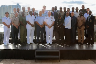 SAN JUAN, Puerto Rico – Chiefs of defense and public security ministers from 22 nations pose for an official photograph during the fifteenth Caribbean Nations Security Conference (CANSEC) Dec. 7 in San Juan, Puerto Rico. The leaders participated in the annual conference to examine trends, challenges and threats impacting stability in the Caribbean and define a collective strategy to improve their forces' collaboration in support of regional security. (photo by U.S. Army Sgt. Alexis Velez Rodriguez)