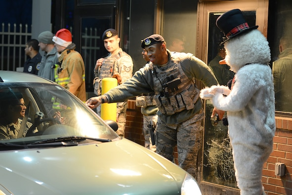 Senior Airman Rico Allen, a fire team member with the 910th Security Forces Squadron, returns an identification card to a 910th Citizen Airman at the main gate as part of an ID check here, Dec. 4, 2016. Members of the 910th SFS are on duty 24 hours a day, seven days a week, 365 days a year to provide force protection for the personnel assigned to YARS. (U.S. Air Force photo/Tech. Sgt. James Brock)