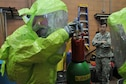 Staff Sgt. Scott Carey, a firefighter with the 910th Civil Engineer Squadron (CES), evaluates 910th CES Firefighter Tech. Sgt. Owen Brownfield here, Dec. 4, 2016, as he completes his Hazardous Materials (HAZMAT) training. The training is required for firefighters and enables them to safely and proficiently deal with any hazardous materials they may encounter while performing their duties. (U.S. Air Force photo/Staff. Sgt. Rachel Kocin)