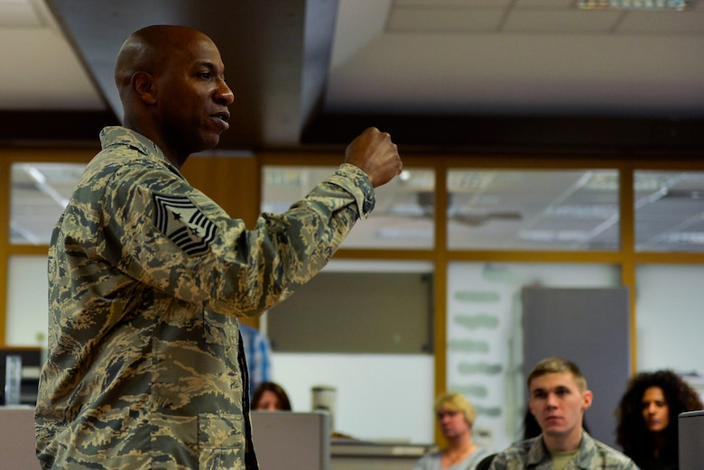 Chief Master Sgt. Kaleth Wright, U.S. Air Forces in Europe and Air Forces Africa command chief, delivers a speech at the 86th Comptroller Squadron at Ramstein Air Base, Germany, Nov. 23, 2016. Wright, who is slated to be the 18th Chief Master Sergeant of the Air Force, spoke to Airmen of all ranks about the importance of mentorship and leadership. (U.S. Air Force photo by Airman 1st Class Joshua Magbanua)