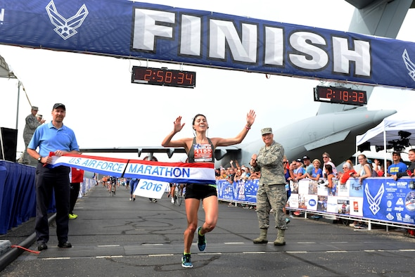 Rachel Harley from Birmingham, Ala., crosses the finish line to become the winner of the 20th U.S. Air Force Marathon women's full marathon division at Wright-Patterson Air Force Base, Ohio, with a time of 2:58:34 (U.S. Air Force photo / Wesley Farnsworth)