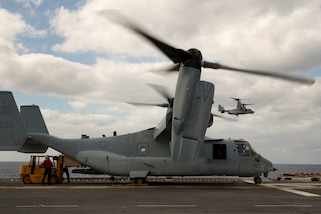 MV-22 Ospreys with Marine Medium Tiltrotor Squadron 365 (Reinforced), 24th Marine Expeditionary Unit arrive on the amphibious assault ship USS Iwo Jima (LHD-7) at Sea, Oct. 10, 2016. Marines and sailors are underway with USS Iwo Jima to support Humanitarian Assistance/ Disaster Relief (HA/DR) missions in the wake of Hurricane Matthew in Haiti. (U.S. Marine Corps photo by Cpl. Hernan Vidana)