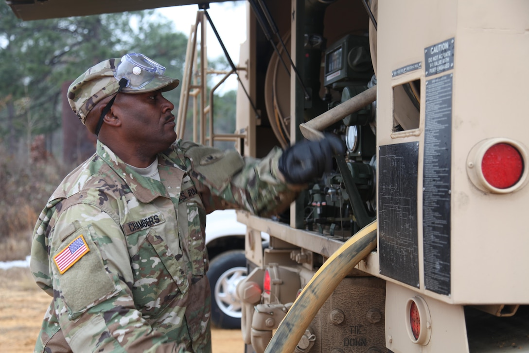 Sgt. Curtis Chambers, 459th Transportation Company, recovers fuel pump after fueling up generators Sgt. Curtis Chambers, 459th Transportation Company, fuels a generator, during an airborne operation, for the XIX Annual Randy Oler Memorial Operation Toy Drop, hosted by U.S. Army Civil Affairs & Psychological Operations Command (Airborne), at Luzon Drop Zone on Dec. 12, 2016. Operation Toy Drop is the world's largest joint and combined airborne operation and collective training exercise with paratroopers from eight partner-nations. (U.S. Army photo by Spc. Lisa Velazco/Released)