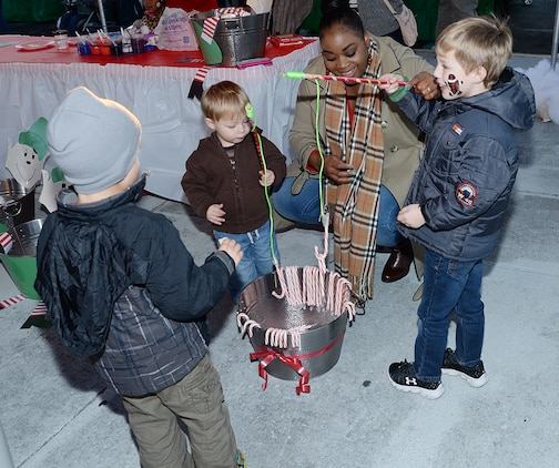 Children play candy cane fishing at a Christmas Tree Lighting Ceremony at Marine Corps Logistics Base Albany, Dec. 9.